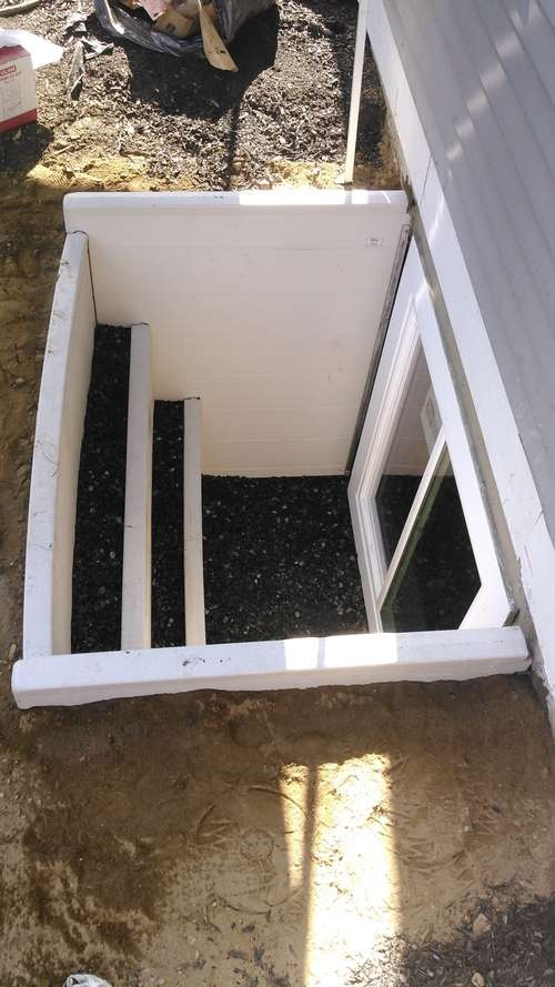 basement-egress-window-stone-backfill