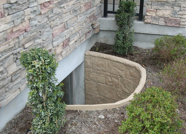 how to prevent basement window wells from flooding
